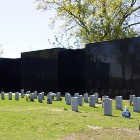 Black wall with headstones